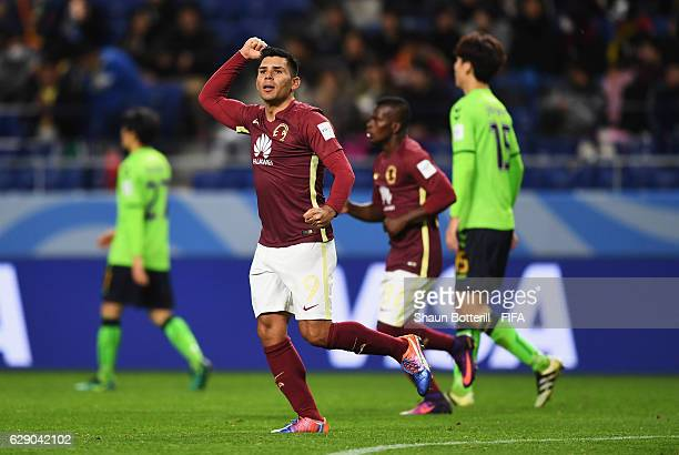 Silvio Romero of Club America celebrates scoring his team's opening goal during the FIFA Club World Cup second round match between Jeonbuk Hyundai...
