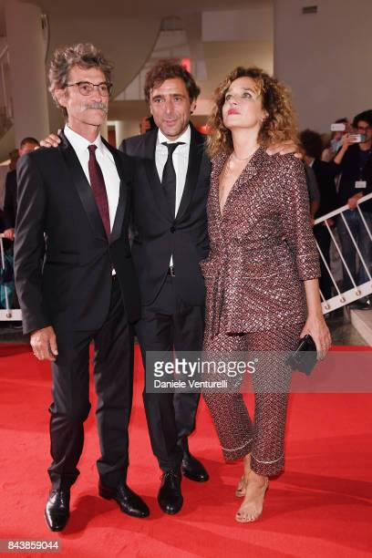 Silvio Soldini Adriano Giannini and Valeria Golino walk the red carpet ahead of the 'Emma ' screening during the 74th Venice Film Festival at Sala...