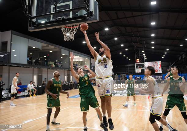 Sim Bhullar of Yulon Luxgen Dinos attempt the basket during the SBL Finals Game Six between Taiwan Beer and Yulon Luxgen Dinos at Hao Yu Trainning...