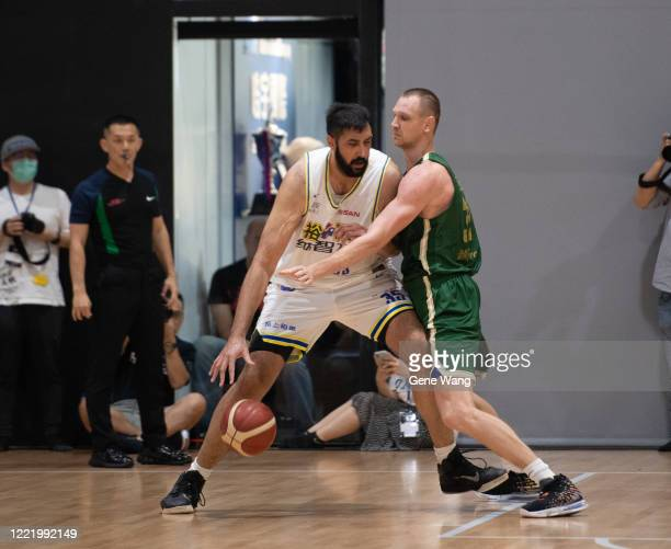 Sim Bhullar of Yulon Luxgen Dinos attempts low post during the SBL Finals Game Six between Taiwan Beer and Yulon Luxgen Dinos at Hao Yu Trainning...