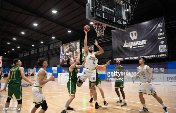 Sim Bhullar of Yulon Luxgen Dinos attempts the basket during the SBL Finals Game Six between Taiwan Beer and Yulon Luxgen Dinos at Hao Yu Trainning...