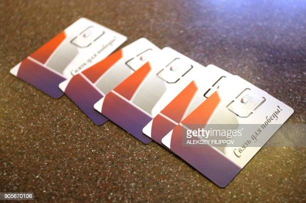 Sim cards of mobile operator 'Phoenix' with a slogan reading 'Connection for the victory' are displayed in Donetsk on January 15 2018 Almost two...