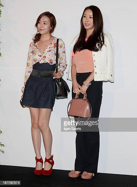 Sim EunJin and Kim EZ attend 'Han JaeSeok and Park SolMi's Wedding' at Walkerhill Aston House on April 21 2013 in Seoul South Korea