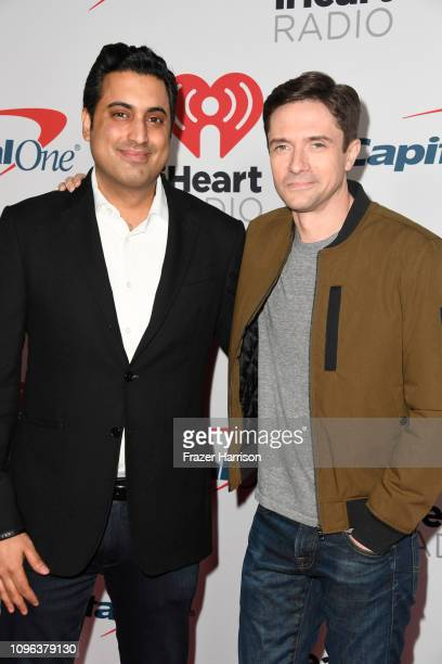 Sim Sarna Topher Grace attend the iHeartRadio Podcast Awards Presented By Capital One at iHeartRadio Theater on January 18 2019 in Burbank California