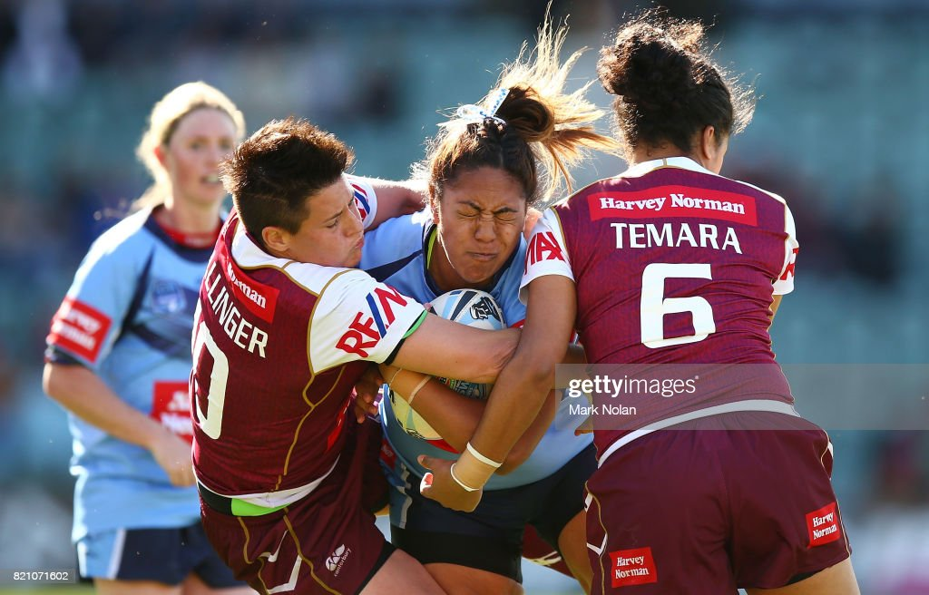 Simaima Taufa of NSW is tackled during the Women's Interstate Challenge match between New South Wales and Queensland at WIN Stadium on July 23, 2017 in Wollongong, Australia.