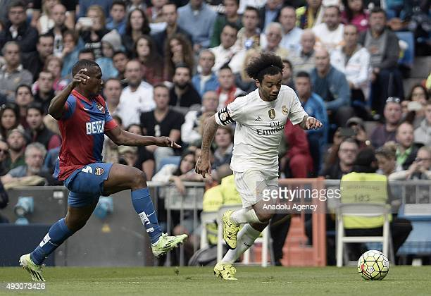 Simao Junior of Levante battles for the ball against Marcelo Vieira of Real Madrid during the La Liga match between Real Madrid CF and Levante UD at...