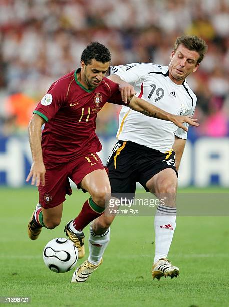 Simao Sabrosa of Portugal holds off Bernd Schneider of Germany during the FIFA World Cup Germany 2006 Third Place Playoff match between Germany and...