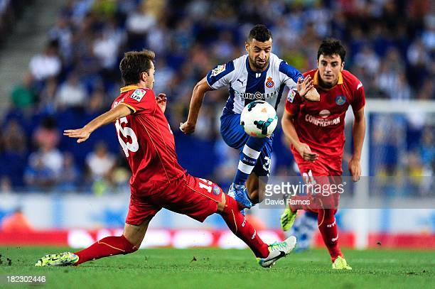 Simao Sabrosa of RCD Espanyol duels for the ball with Rafael Lopez and Michel Madera of Getafe CF during the La Liga match between RCD Espanyol and...