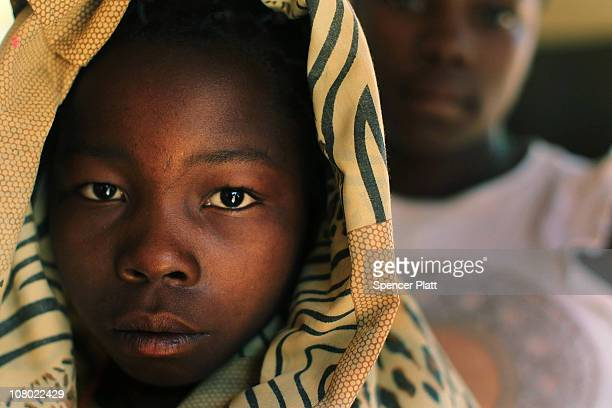 Simba one of thousands of children who had been kidnapped by the Lords Resistance Army and used as slaves stands at a halfway house for child victims...