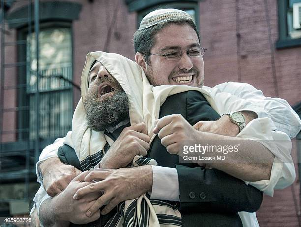 Simchat Torah, a happy celebration in Judiasm when Jews carry the TORAH outside of the synagogue and men dance with men leap frogging etc...