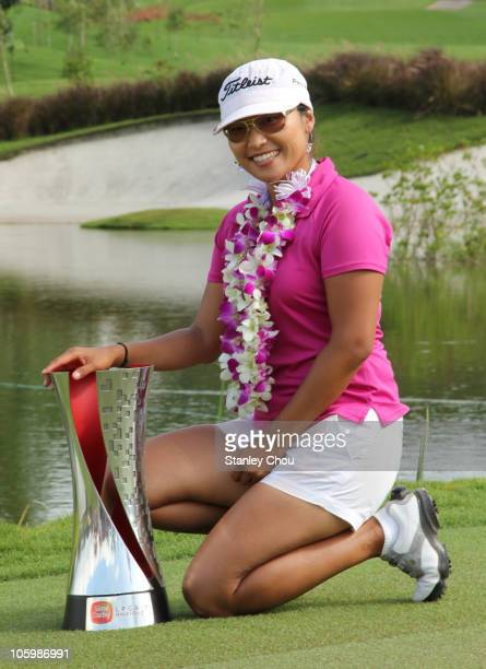 Sime Darby LPGA Champion Jimin Kang of South Korea poses with her Trophy after the presentation ceremony during the Final Round of the Sime Darby...