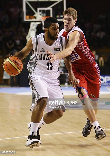 Sime Olivari of Croatia tries to steal the ball from Dion Prewster of New Zealand during the FIBA Under 19 World Championship match between New...