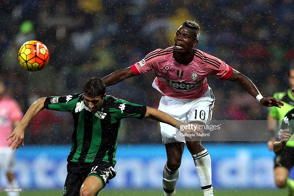 Sime Vraljko of US Sassuolo Calcio battles for the ball with Paul Pogba of Juventus FC during the Serie A match between US Sassuolo Calcio and Juventus FC at Mapei Stadium - Città del Tricolore on October 28, 2015 in Reggio nell'Emilia, Italy.
