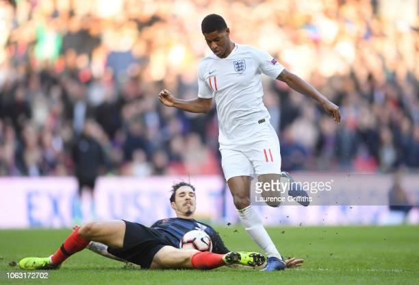 Sime Vrsaijko of Croatia tackles Marcus Rashford of England during the UEFA Nations League A group four match between England and Croatia at Wembley...