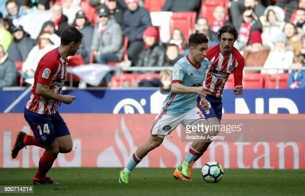 Sime Vrsaljko and Gabi of Atletico Madrid in action Emre Mor of Celta Vigo during the La Liga soccer match between Atletico Madrid and Celta Vigo at...