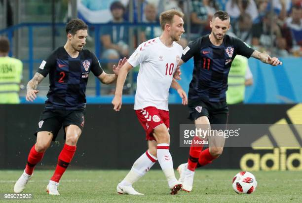 Sime Vrsaljko and Marcelo Brozovic of Croatia national team vie for the ball with Christian Eriksen of Denmark national team during the 2018 FIFA...