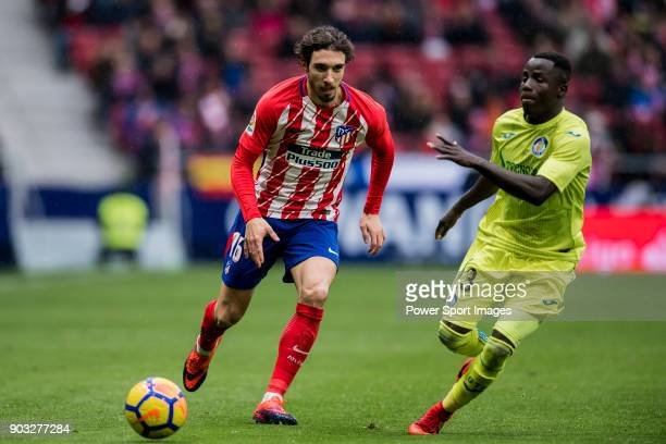 Sime Vrsaljko of Atletico de Madrid fights for the ball with Amath Ndiaye Diedhiou of Getafe CF during the La Liga 201718 match between Atletico de...