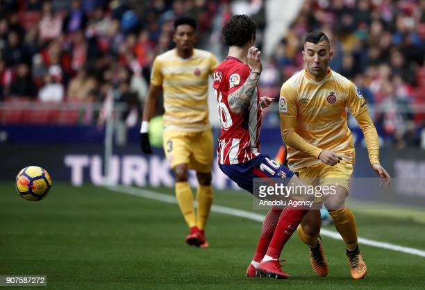 Sime Vrsaljko of Atletico Madrid and Borja Garcia of Girona vie for the ball during the La Liga match between Atletico Madrid and Girona at the Wanda...