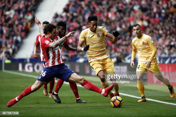 Sime Vrsaljko of Atletico Madrid and Johan Mojica of Girona vie for the ball during the La Liga match between Atletico Madrid and Girona at the Wanda...