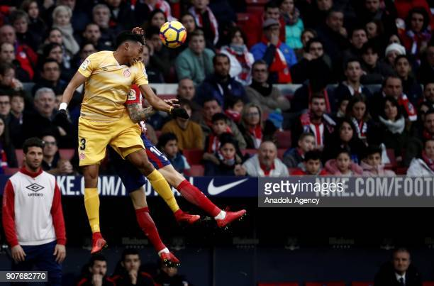 Sime Vrsaljko of Atletico Madrid and Johan Mojica of Girona vie for the ball during a La Liga match between Atletico Madrid and Girona at the Wanda...