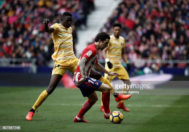 Sime Vrsaljko of Atletico Madrid and Michael Olunga of Girona vie for the ball during the La Liga match between Atletico Madrid and Girona at the...