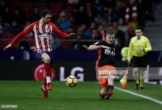 Sime Vrsaljko of Atletico Madrid and Toni Lato of Valencia vie for the ball during the La Liga match between Atletico Madrid and Valencia at the...