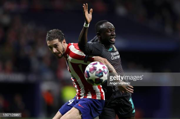 Sime Vrsaljko of Atletico Madrid battles for possession with Sadio Mane of Liverpool during the UEFA Champions League round of 16 first leg match...