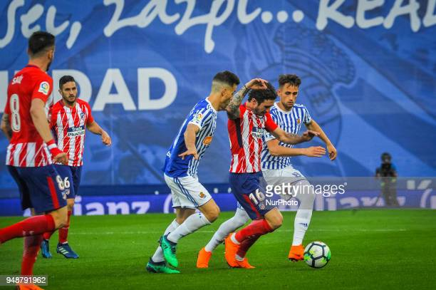Sime Vrsaljko of Atletico Madrid duels for the ball with Sergio Canales and Adnan Januzaj of Real Sociedad during the Spanish league football match...