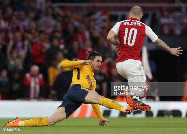 Sime Vrsaljko of Atletico Madrid fouls Jack Wilshere of Arsenal during the Europa League semi final leg one match between Arsenal and Atletico Madrid...