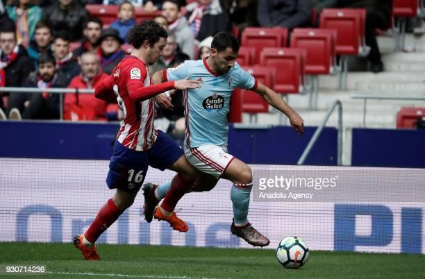 Sime Vrsaljko of Atletico Madrid in action against Johny Castro of Celta Vigo during the La Liga soccer match between Atletico Madrid and Celta Vigo...