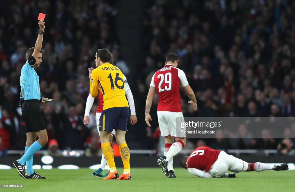 Sime Vrsaljko of Atletico Madrid is shown a red card during the UEFA Europa League Semi Final leg one match between Arsenal FC and Atletico Madrid at Emirates Stadium on April 26, 2018 in London, United Kingdom.