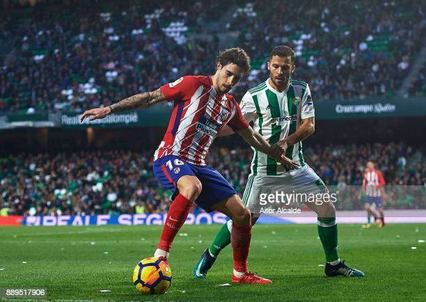 Sime Vrsaljko of Club Atletico de Madrid competes for the ball with Riza Durmisi of Real Betis Balompie during the La Liga match between Real Betis...