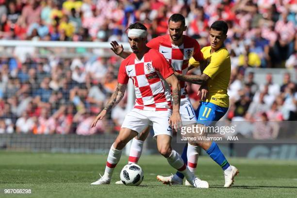 Sime Vrsaljko of Croatia and Marcelo Brozovic of Croatia and Philippe Coutinho of Brazil during the International friendly match between Croatia and...