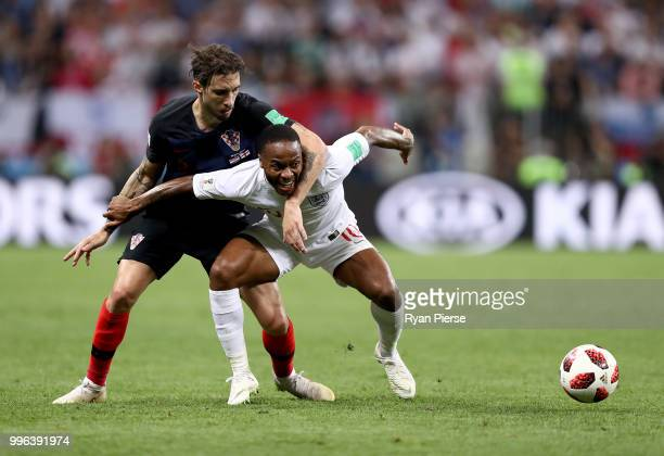 Sime Vrsaljko of Croatia challenges Raheem Sterling of England during the 2018 FIFA World Cup Russia Semi Final match between England and Croatia at...