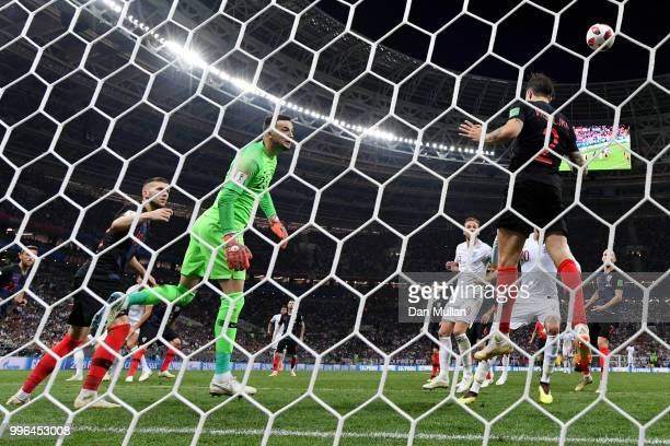 Sime Vrsaljko of Croatia clears of the line from a header from John Stones of England during the 2018 FIFA World Cup Russia Semi Final match between...