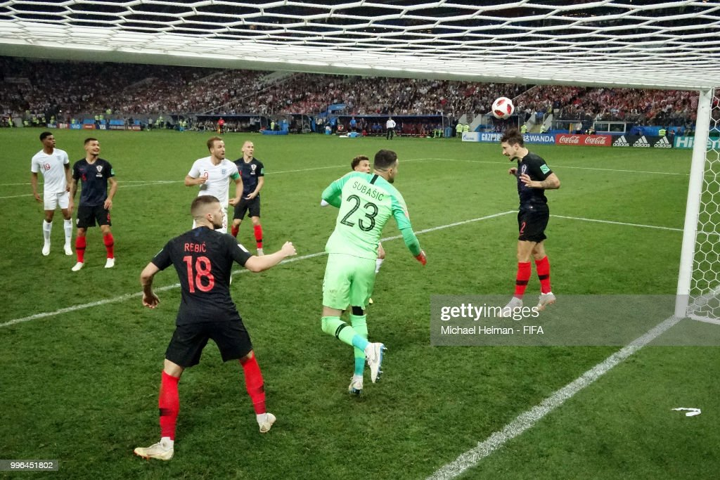 Sime Vrsaljko of Croatia heads the ball clear of the line from a header on target from John Stones of England during the 2018 FIFA World Cup Russia Semi Final match between England and Croatia at Luzhniki Stadium on July 11, 2018 in Moscow, Russia.