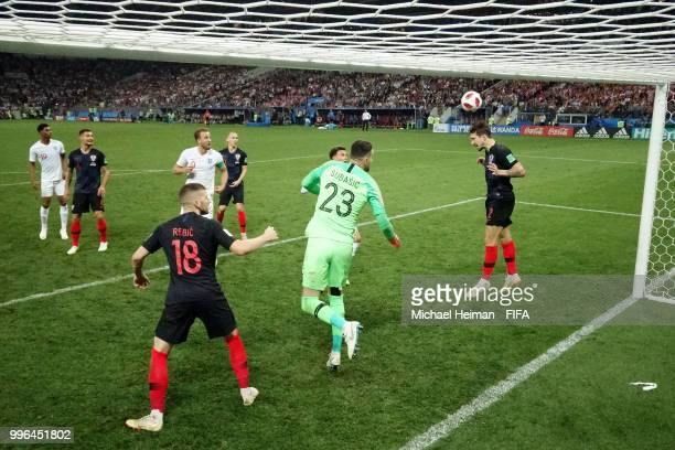 Sime Vrsaljko of Croatia heads the ball clear of the line from a header on target from John Stones of England during the 2018 FIFA World Cup Russia...