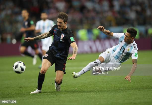 Sime Vrsaljko of Croatia vies with Maximiliano Meza of Argentina during the 2018 FIFA World Cup Russia group D match between Argentina and Croatia at...