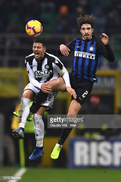 Sime Vrsaljko of FC Internazionale competes for the ball with Rolando Mandragora of Udinese during the Serie A match between FC Internazionale and...