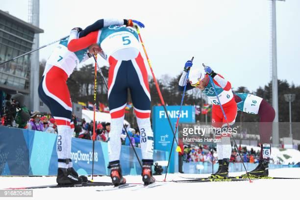 Simen Hegstad Krueger Hans Christer Holund and Martin Johnsrud Sundby of Norway react after the Men's 15km and 15km Skiathlon CrossCountry Skiing on...