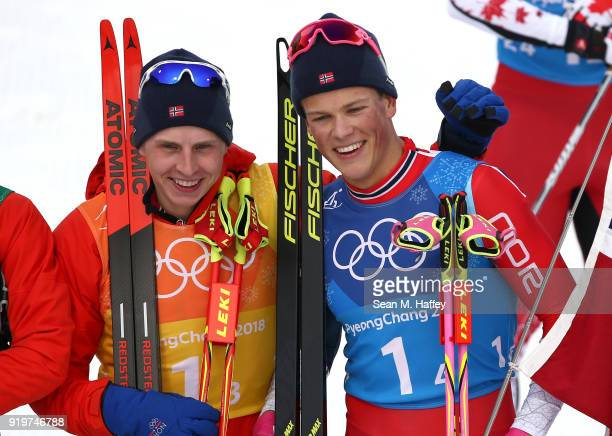 Simen Hegstad Krueger of Norway and Johannes Hoesflot Klaebo of Norway celebrate after winning the gold medal during CrossCountry Skiing men's 4x10km...