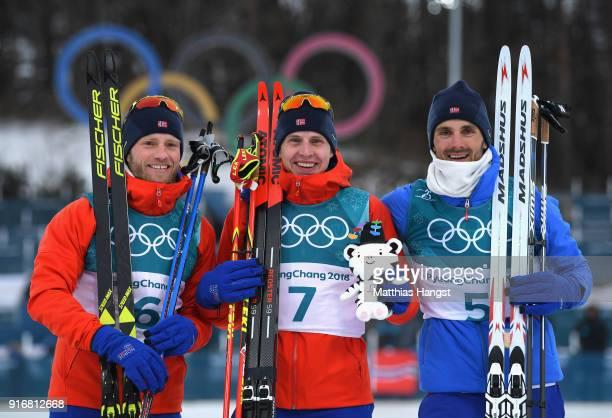 Simen Hegstad Krueger of Norway celebrates winning the gold medal with silver medallist Martin Johnsrud Sundby of Norway and bronze medallist Hans...