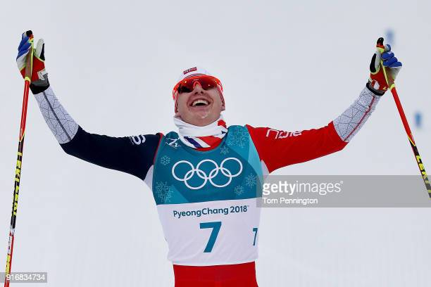Simen Hegstad Krueger of Norway celebrates winning the gold medal during the Men's 15km and 15km Skiathlon CrossCountry Skiing on day two of the...