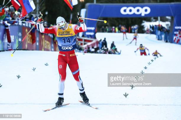 Simen Hegstad Krueger of Norway takes 1st place during the FIS Nordic World Cup Men's and Women's Cross Country Mass Start on January 5, 2020 in Val...