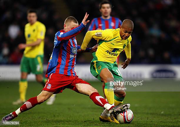 Simeon Jackson of Norwich City battles for the ball with Matt Parsons of Crystal Palace during the npower Championship match between Crystal Palace...