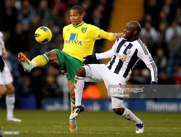 Simeon Jackson of Norwich controls the ball ahead of Youssouf Mulumbu of WBA during the Barclays Premier League Match between West Bromwich Albion...