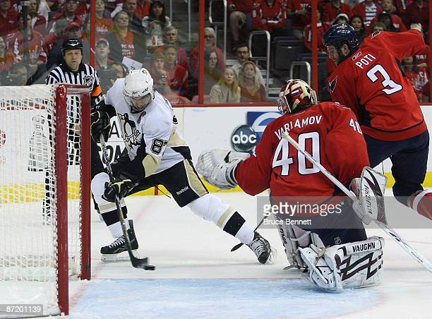 Simeon Varlamov of the Washington Capitals fails to stop a first period goal by Sidney Crosby of the Pittsburgh Penguins during Game Seven of the...