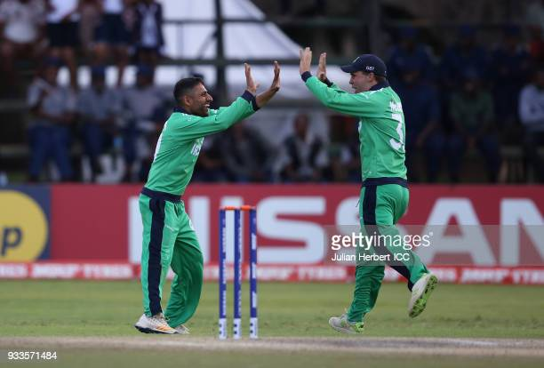 Simi Singh of Ireland and Andrew McBrine celebrate the wicket of Michael Leask of Scotland during The Cricket World Cup Qualifier between Ireland and...