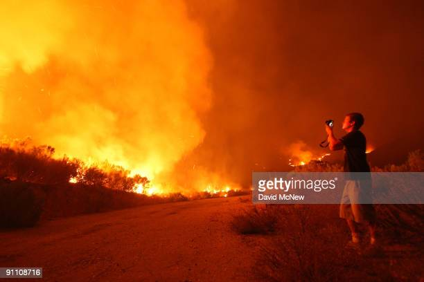 Simi Valley California resident Mike Celic photographs uncontrolled flames on the eastern flank of the 16000plusacre Guiberson fire burning out of...
