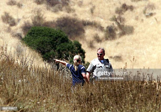 Simi Valley resident Erin McGuire with CHP officer Dave Wigton searching a ravine on the hills north of Presidio Dr McGuire called the police after...